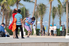 Close encounters... (Roving I) Tags: puzzling couples skateboarders concentration beaches palmtrees motion action balance tattooes danang vietnam activities recreation tourism