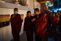 Tibetan monks making Kora, Boudhanath, Kathmandu, Nepal (Alex_Saurel) Tags: group asie culture 35mmprint pilgrimage scans སྐོར་ར prayerwheels tibetantmonk rouge asian kora masque groupe tibetanmonk moulinsàprière mask red moinebouddhiste motif moinetibétain walking bouddhisme tibetanbuddhism pattern circumambulation buddhism kasaya people buddhistmonk khāsacaitya action boudhanath kesa asia streetscene khāsti travel sanctuairebouddhiste lifescene बौद्धनाथ imagetype buddhistsanctuary photospecs photoreport jarungkhashor photoreportage reportage kathmandu nuit bouddhanath prayerwheel night bodnath byarungkhashor photojournalism main religion stockcategories hand traditional time katmandou shaved tradition nepal scènedevie lifestyles sony50mmf14sal50f14