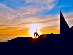 One with the Sun (moonjazz) Tags: yoga meditation sky people woman color orange blue california inspiration zen sun sunset oneness photography prayer santacruz twilight nature universe connection strong stretch