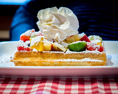 Yummy Belgium Waffle with fruit and whipped cream! (Tex Texin) Tags: belgium bruges brugge europe flanders destination tourist travel yummy waffle kiwi fruit strawberry cream whipped peaches colorful delicious tasty food dessert