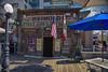 Open (msuner48) Tags: d750 acr5 cs4 bar saloon historic flags doorway streetlamp tables umbrellas sky signs jacklondonsquare oaklandca nikcollection nikonafs24120mmf4ged