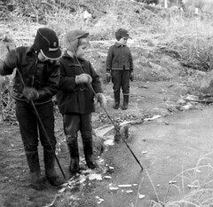 Ice Breaking (theirhistory) Tags: boys children kids water pond play ice hat cap wellies trousers jacket stick boots