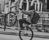 "Biker Doing Wheely On Water Street Manhattan (nrhodesphotos(the_eye_of_the_moment)) Tags: dsc090263001804 ""theeyeofthemoment21gmailcom"" ""wwwflickrcomphotostheeyeofthemoment"" winter2018 manhattan bw bikers wheely bokeh spokes panning outdoors"