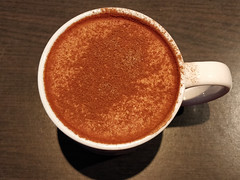 Warming up with a chai latte on a frigid day (Ruth and Dave) Tags: gonebakery whistler whistlervillage whistlerblackcomb cafe chailatte tea drink spices cinnamon hotdrink beverage