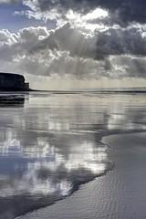 Skin on skin (pauldunn52) Tags: beach wick cwm nash glamorgan heritage coast wales wet sand edge light sun shafts cliffs