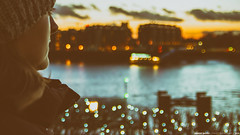 your possible pasts... (Anand Balaji) Tags: london thames sunset moody photo filter woman female feminine lights bokeh reflection england europe canarywharf westferry circus