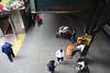 Flower Seller (Blinking Charlie) Tags: bushwick brooklyn newyorkcity nyc newyork elevated el mta subway station sidewalk pedestrians sonydscrx100m3 blinkingcharlie usa 2017
