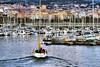 Diumenge a la tarda: El retorn (Fnikos) Tags: port porto puesto harbour sea water waterfront people city boat sailboat mountain nature outdoor