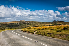 Road across the moor (The Frustrated Photog (Anthony) ADPphotography) Tags: category dartmoor devon england landscape places travel canon1585mm canon70d canon hills moor moors route hill grass heather gauze sky blue bluesky whiteclouds clouds travelphotography landscapephotography scenery nature natural countryside rural uk unitedkingdom greatbritain outdoor road cloud rock rocks tor
