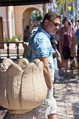 Man and Lotus Wall (LarryJay99 ) Tags: 2018 urban festivals crowds people men male man guy guys dude dudes detail fence barriers rails stoa crowd shadows sunglasses hunkydude glassesface handsome facialhair lakeworth cargopants cargos hairy arms hairyarms lakeworthstreetpaintingfestival2018 mustache lightshadows