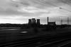 Rugeley power station (Gary Kinsman) Tags: rugeleypowerstation rugeley powerstation westcoastmainline train onthemove movement motion motionblur moving longexposure bw blackwhite traintracks trainlines lines cables travel journey fujix100t fujifilmx100t 2017 coolingtowers pylons staffordshire coalfiredpowerstation coal
