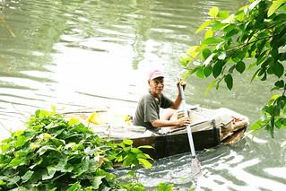 man paddling homemade boat