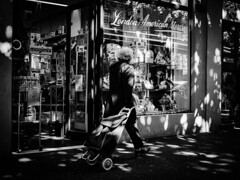 London & American Store (Ross Major) Tags: black white bw street person woman trolley store london american melbourne