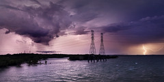 Channel Island Lightning (Louise Denton) Tags: electricity electric storm lightning bolts weather stormy cg river harbour sea island bridge pylon sunset night purple bolt darwin wetseason tropical australia
