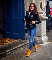 Blue (Owen J Fitzpatrick) Tags: ojf people photography nikon fitzpatrick owen pretty pavement chasing d3100 ireland editorial use only ojfitzpatrick eire dublin republic city tamron candid joe candidphotography candidphoto unposed natural attractive beauty beautiful woman female lady j face hair along bw black white mono photoshoot street 2017 centre stephens green jeans torn bubble coat jacket brunette boot laces tan door entrance phone device hold long fashion pants doorway eye contact mosaic blue open bleu