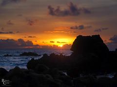 Blackrock Sunrise (RobertCross1 (off and on)) Tags: 1250mmf3563mzuiko em5 hawaii molokai omd oahu olympus pacific pacificocean sandybeach sunrisebeach beach clouds island landscape lava nature ocean rocks sea seascape sun sunrise surf tidepool vog volcanic water waves hawaiikai honolulu