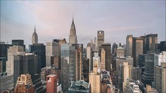 Morning Skyline Cloud Time Lapse (Michael.Lee.Pics.NYC) Tags: newyork timelapse video motion clouds rooftops aerial hotelwithview millenniumhiltononeunplaza architecture cityscape chryslerbuilding esb empirestatebuilding sony a7rm2 zeissloxia21mmf28