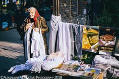 Red Scarf (Aleksandar M. Knezevic Photography) Tags: belgrade beograd serbia srbija street market old woman selling pants tito slava life gace urban documentary red scarf ngc