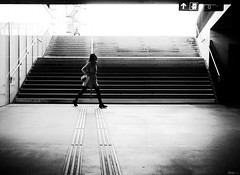 don't be too late (René Mollet) Tags: woman hurry leat blackandwhite bw oerlikon zürich penf people passage photo18 renémollet street streetphotography shadow silhouette streetart streetphotographiebw station urbanstreet urban