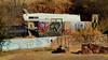Go Gently - suburban trailer homestead, Bisbee, Arizona (edk7) Tags: nikond3200 edk7 2013 us usa arizona cochisecounty bisbee earlymorning trailer mural wallart homestead suburb car vehicle rock grass concrete wall