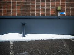 P1090645 (vargandras) Tags: wall pipe wire brick steel box line carpark tarmac snow sign p wet