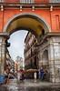 Arch in Madrid, Spain (` Toshio ') Tags: toshio madrid spain plazamayor arch oldtown people churchtower church towers rain europe european europeanunion architecture city fujixe2 xe2 raining man woman parroquianuestraseñorabuenconsejo
