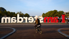 morning bike commute in front of I amsterdam sign (FlorianMilz) Tags: amsterdam noordholland netherlands nl iamsterdam sign bike bicycle bikelife adidas bag sports sun sunrise light red white earlymornings museumpplein sightseeing local