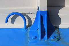 blue colored shapes (claredlgm1) Tags: geometric curves blue metal iron boat detail white shapes abstract