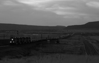 A long BNSF Z-ATGSBD7-05 stack train lead by ES44C4 6696 heads East from Seligman at sunset.