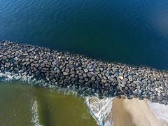 The rocks along the Mansquant Inlet, captured by a DJI Phantom 4 drone. (apardavila) Tags: atlanticocean djiphantom4 fb jerseyshore manasquan manasquanbeach manasquaninlet aerial beach drone morning rocks sky snow