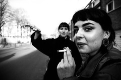 IMG_1269 (JetBlakInk) Tags: composition mono smoking streetscene women streetphotography portrait face noserings profile