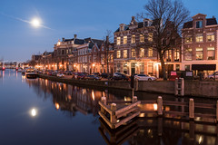 Blue Moon (McQuaide Photography) Tags: haarlem noordholland northholland netherlands nederland holland dutch europe sony a7riii ilce7rm3 alpha mirrorless 24105mm sonyfe24105mmf4g fullframe mcquaidephotography lightroom adobe photoshop tripod manfrotto stad city urban waterside lowlight bluehour twilight schemering outdoor outside building longexposure sky water reflection river spaarne rivier calm tranquil peaceful winter serene wideangle groothoek moon maan cityscape stadsgezicht