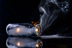 In a Bottle...HMM! (Christina Draper) Tags: smoke sparkler bokeh bottle reflection hmm macromondays inabottle theme in