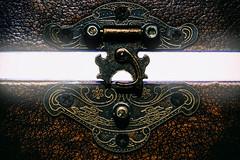 Keep A Lock On Pandora's Box (Mark Wasteney) Tags: macromondays fastener box leather lock metal metallic screws textures brown patterns light torchlight catch fasteners
