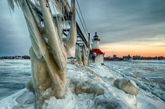Sunset on ice #6 (tquist24) Tags: hdr lakemichigan michigan nikon nikond5300 stjoseph stjosephlighthouse catwalk clouds cold evening frozen geotagged ice icicles lake lighthouse pier sky snow sunset water winter saintjoseph unitedstates