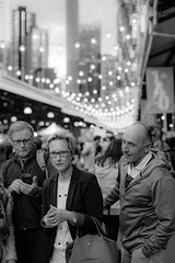 A Stern Gaze  ಠ_ಠ (SemiXposed) Tags: market night queen victoria melbourne australia outdoors summer people lights black white shades glasses older couple city urban crowd eyes gazing focused tourists vacation holidays