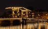 Amsterdam - Magere brug (roelbleeker) Tags: amsterdam night evening dark darksky city cityview citylights cityscape nederland netherlands bridge magere brug magerebrug canal canals lights lighttrail boats boat nikon d750 2401200mmf40