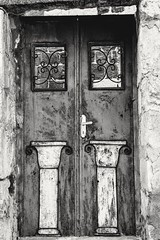 Knock knock!  Who's there?!  It's the Romans, we're on your doors too. (DanaKhoudari) Tags: gold fasteners natural metal romans architecture history black white blackandwhite travel tourist explore inexplore monochrome nocolour nopeople art light city oldcity house old bw weekend weekendtravel