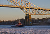 Red Tug in Sunlight (brucetopher) Tags: water ice sunset flow moving motion float floating winter cold arctic arcticblast weather freeze freezing frozen saltwater bay river canal stream current boat tug tugboat bridge light sunlight sunshine warmth