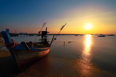 Fishing boat in on the beach at sunset. (Krunja) Tags: background baltic bay beach beautiful blue boat boats calm cloud coast color colorful evening fish fisherman fishing holiday horizon landscape light nature ocean old red sand scenery scenic sea seascape seaside ship shore sky summer sun sunrise sunset thailand tourism traditional transport transportation travel twilight vacation view water wave wooden