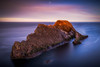 Solo Bow (Augmented Reality Images (Getty Contributor)) Tags: portknockie bowfiddlerock coastline landscape sunset nisifilters scotland water waves longexposure morayfirth canon seascape clouds rocks unitedkingdom gb