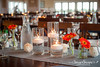 GingerSnaps-1445 (sugarsnapobx) Tags: obxwedding beachwedding pineislandlodge sugarsnapobx sugarsnapevents dayofcoordination centerpieces candles gerberadaisy orange gray