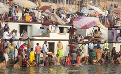 In the holy river (Tim Brown's Pictures) Tags: india varanasi benares ganges river gangesriver religion hindu hinduism pilgrims travel color people boats uttarpradesh