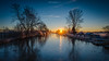The Old Canal (Matt Rimkus Photography) Tags: schleswigholstein trees burst sunrise winter water frost sky reflection clouds star cold ice