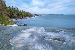 Forceful Sea (tomi.a) Tags: finland suomi porvoo emäsalo sea shore forest rocks ice snow winter wind windy movingwater longexposure trees d850 outdoor nature daylight landscape seascape travel sky clouds horizon water environment