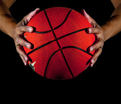 _3001366 (Ncor: Photography) Tags: basketball ball hand player object sphere sports orange black one baller sportsman fit adult athlete leisure action man exercise athletic game team male person circle closeup basket arm caucasian finger sport nba palm seam equipment competition spot single shape trick power play people background dark curve shadow
