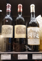 Today's dilemma. Trying to decide on a Valentines Day gift (D70) Tags: which 3 wines should buy maybe will receive discount 733477 total trying decide gift sony dscrx100m5 ƒ25 106mm 130 500 chateau lafite rothschild 2008 1986 hautbrion 2009 todays dilemma bottle bottles wine cabsavignon merlot petit labels price valentines
