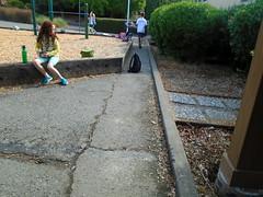 DSC00932 (classroomcamera) Tags: school campus playground lunch snack sit portrait blacktop cracks walk leading lines green grey kid kids girl