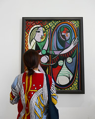 Woman studies Picasso's Jeune fille devant un miroir (Monceau) Tags: pablopicasso jeunefilledevantunmiroir painting young woman portrait mirror mirrored image museumvisitor colorful sweater observes studies