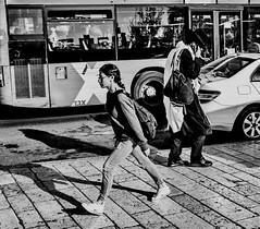 running  in the opposite direction. (Monica@Boston) Tags: walking culture outdoors israel bus noon street jerusalem people